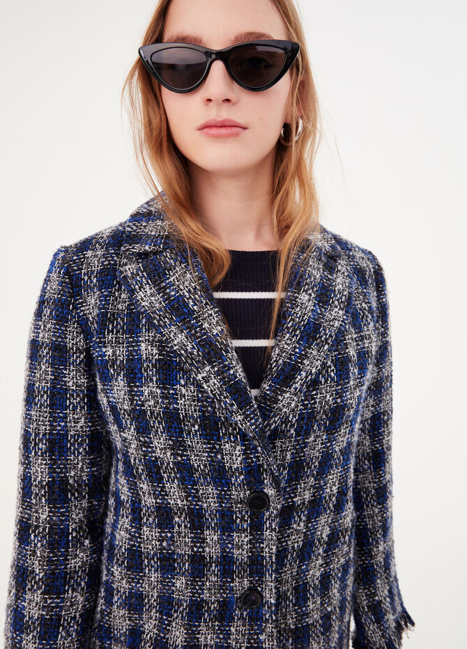 Check coat with fringed edges
