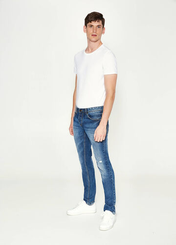 Slim fit jeans with abrasions