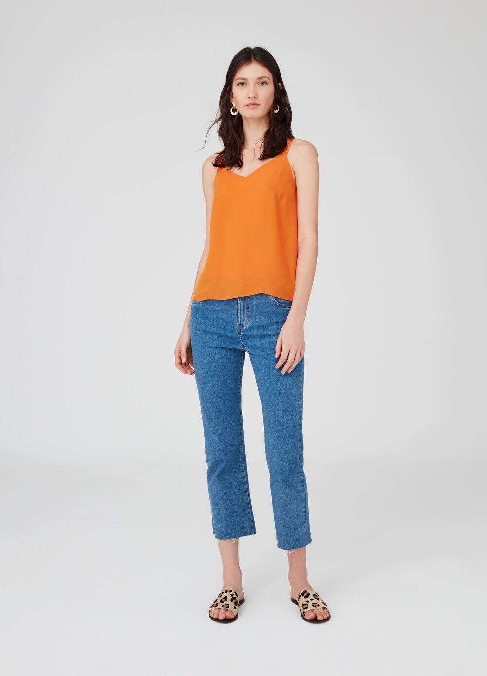 Top with V neck and criss-cross back.