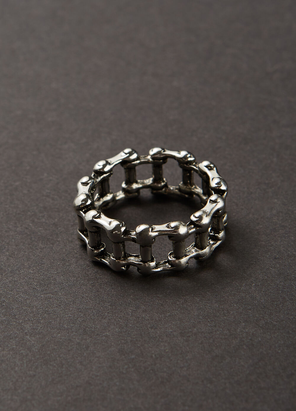 Steel ring with perforated motif