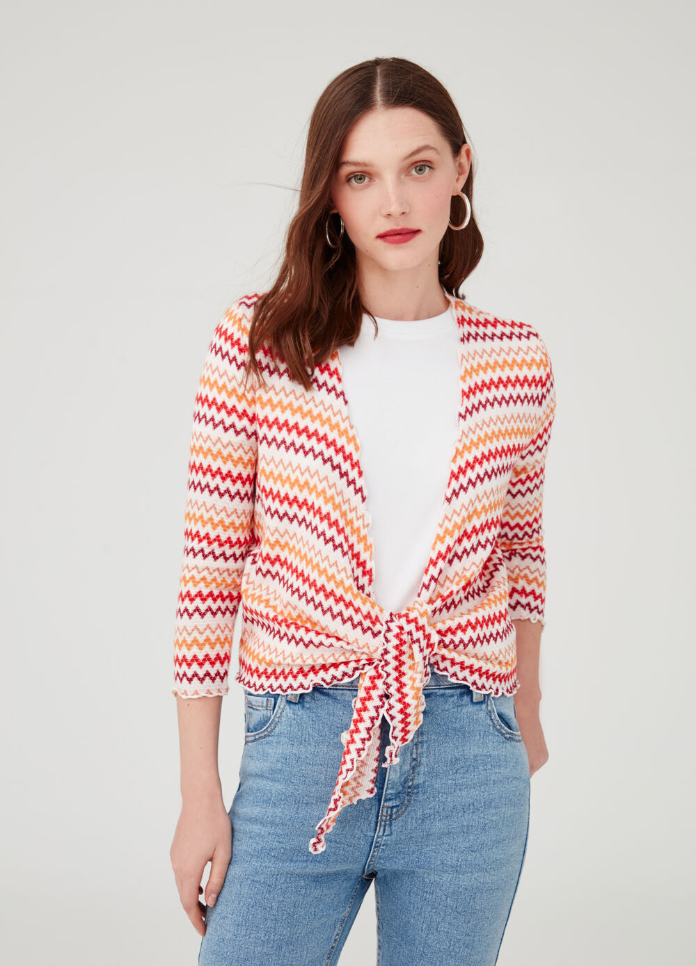 Cardigan with belt at the waist and pattern
