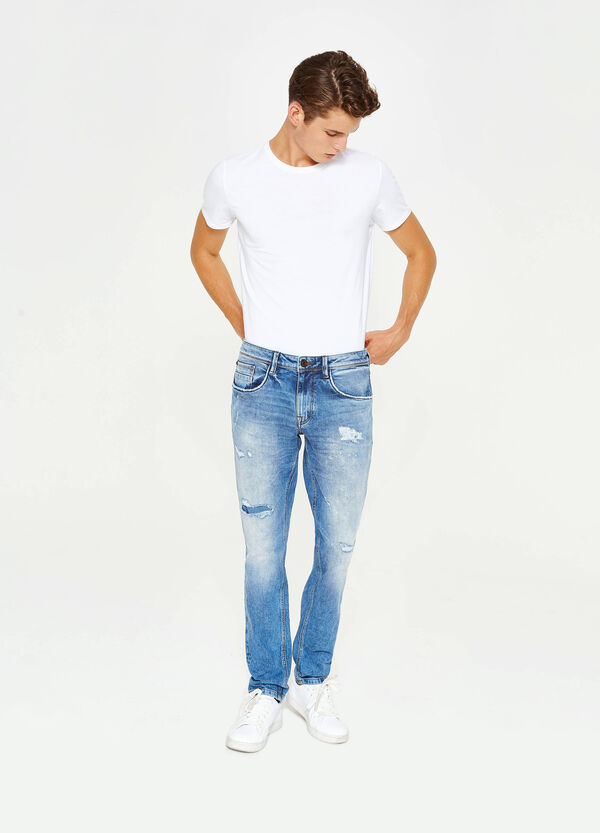 Worn-effect slim-fit stretch jeans with rips
