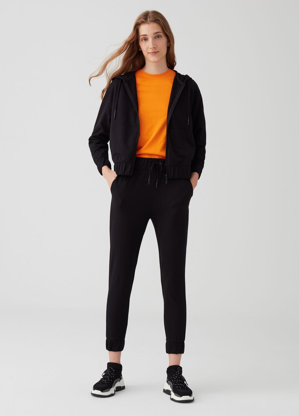 High-waisted crop trousers with elasticated hem