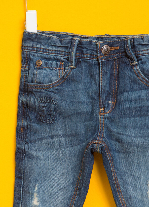 Worn-effect jeans with rips and print | OVS