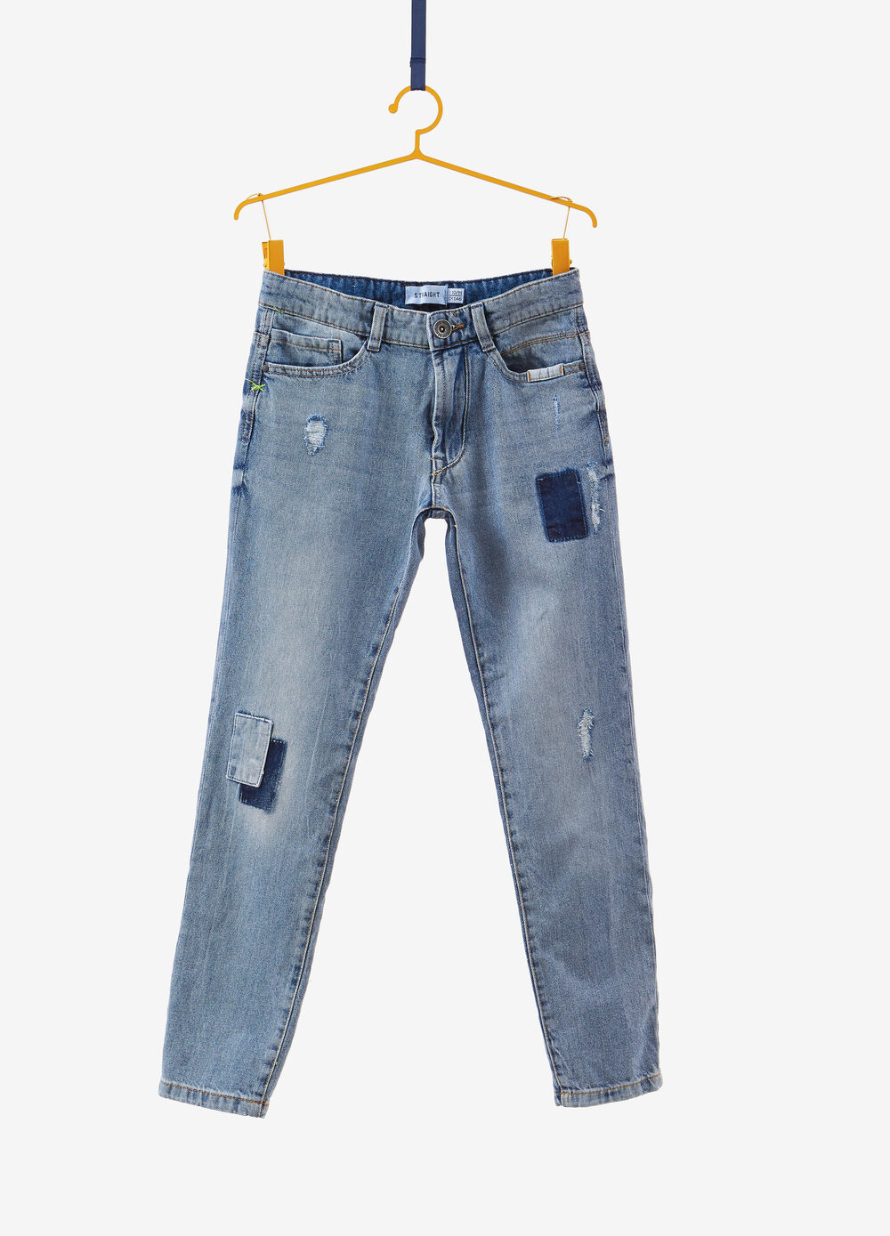 Low-fit jeans with patches and abrasions