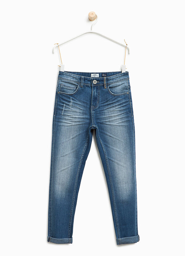 Worn-effects stretch jeans with abrasions | OVS