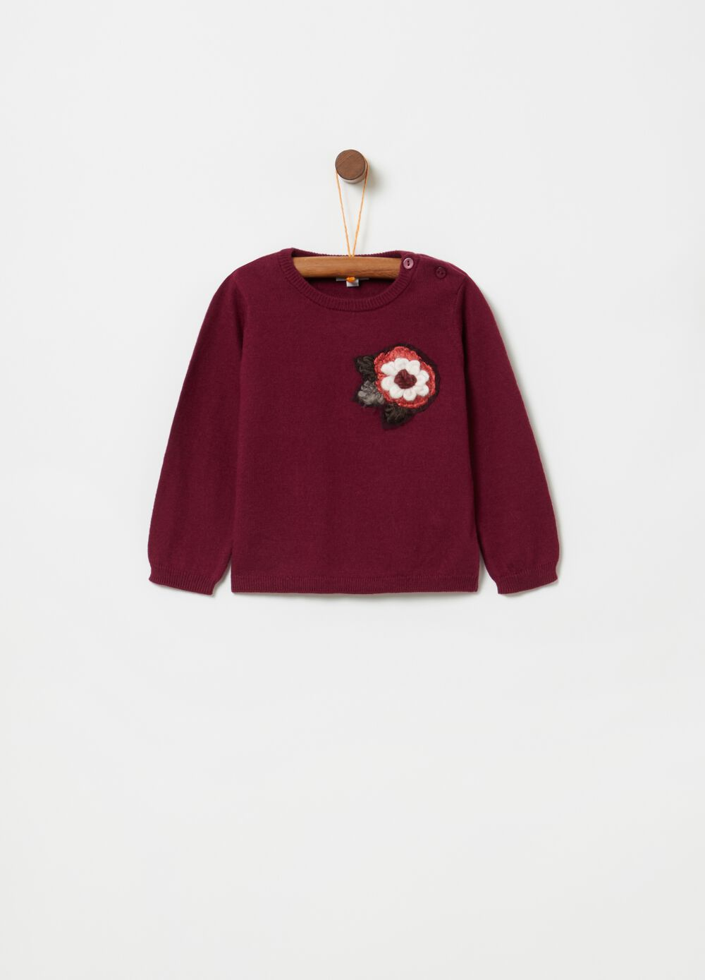 Knitted top with floral application