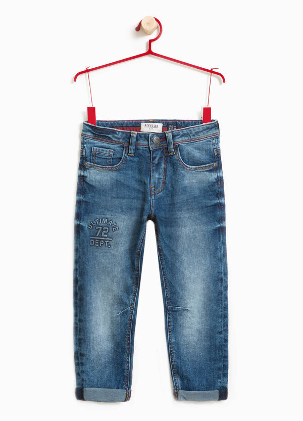 Worn-effect stretch jeans with print | OVS