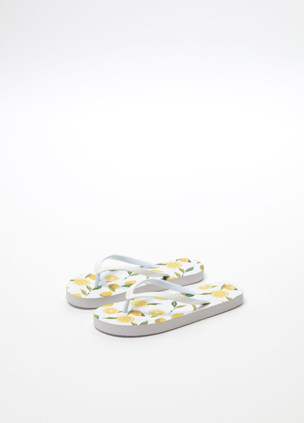 Thong sandals with lemon patterned sole