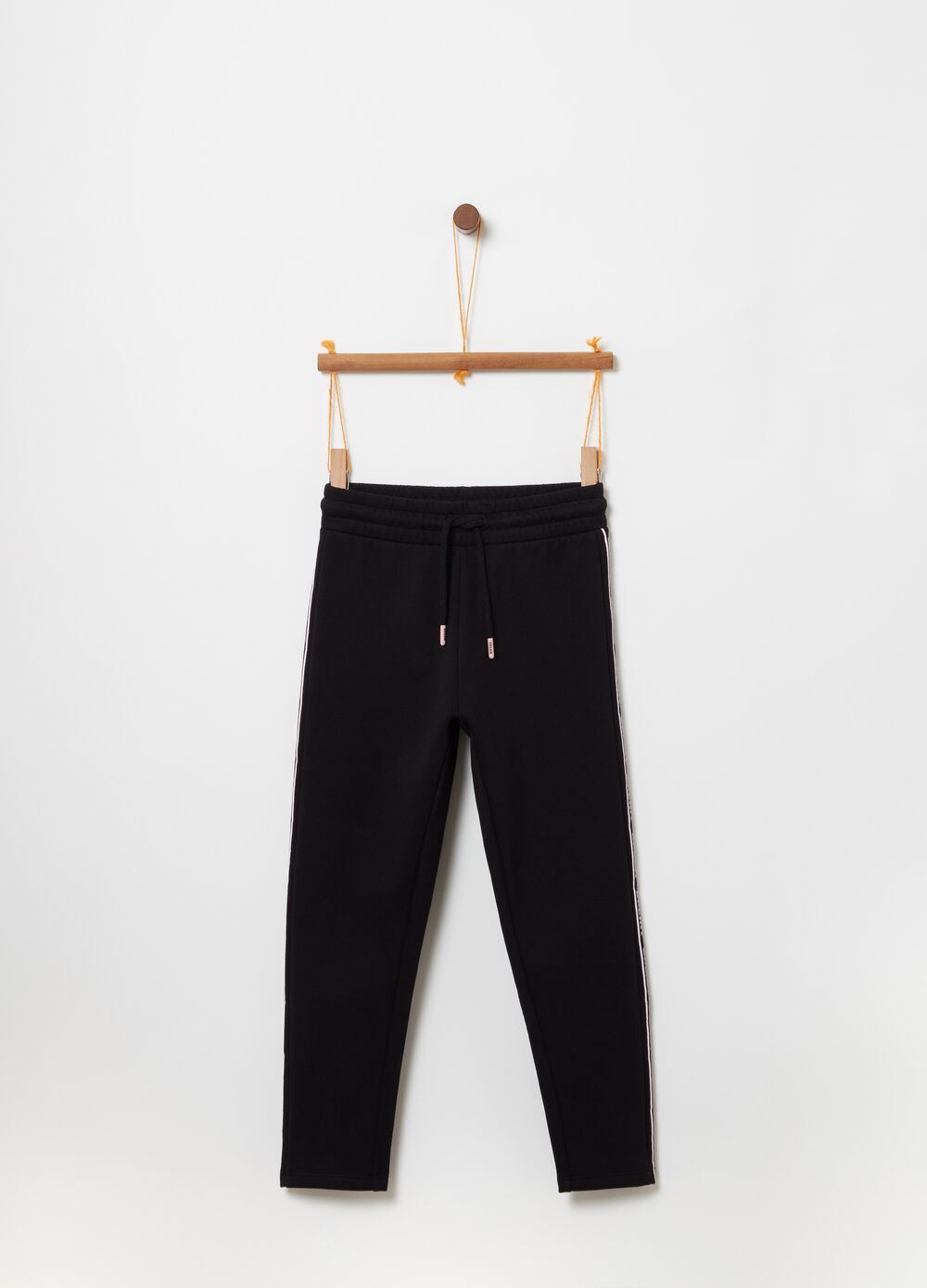 Jogger trousers with glitter print and drawstring