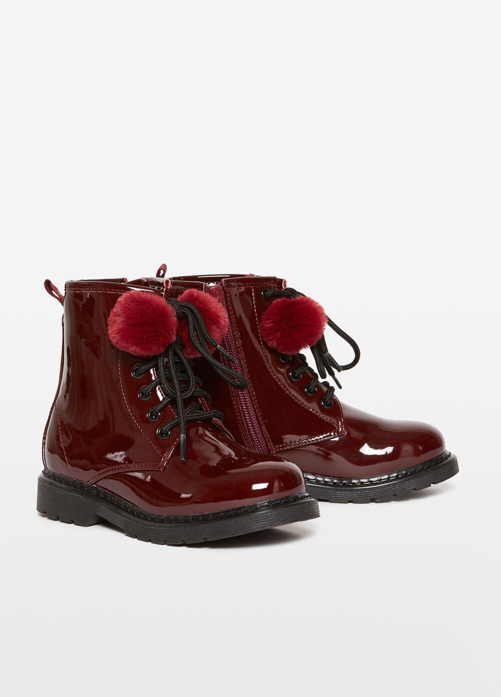 Shiny field boots with pompoms