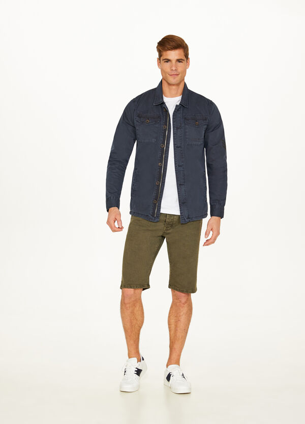Solid colour stretch denim Bermuda shorts
