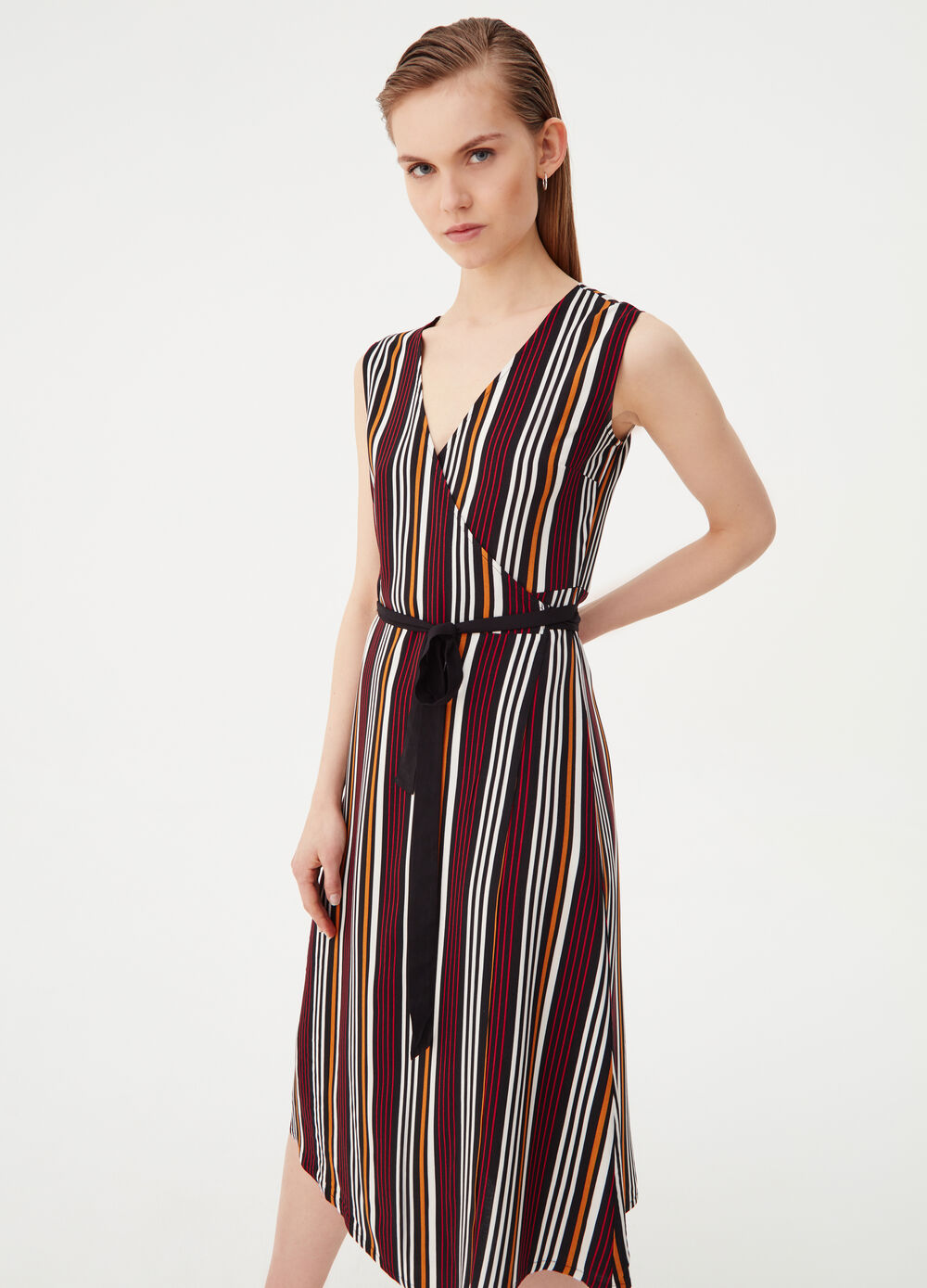 Sleeveless dress with crossover front