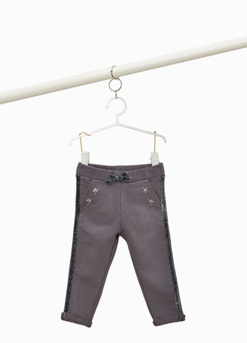 Trousers with glitter bands and diamantés