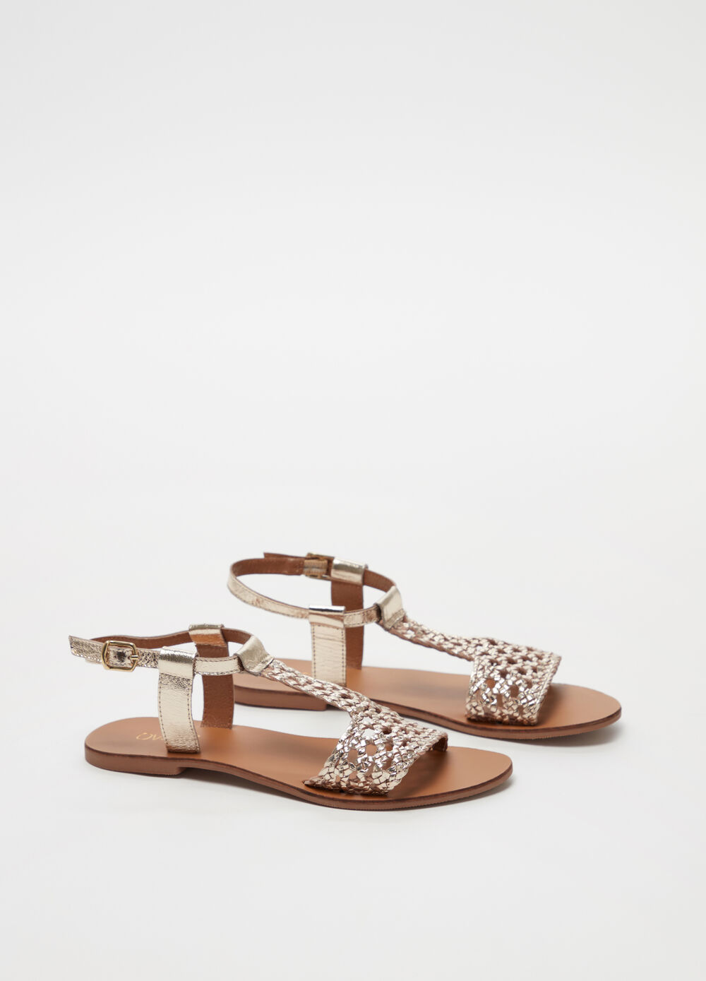 Metallic leather sandal with openwork design