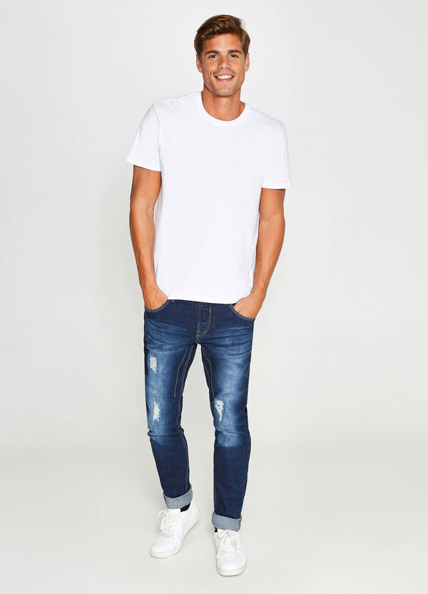 Worn-effect, skinny-fit stretch jeans with rips | OVS