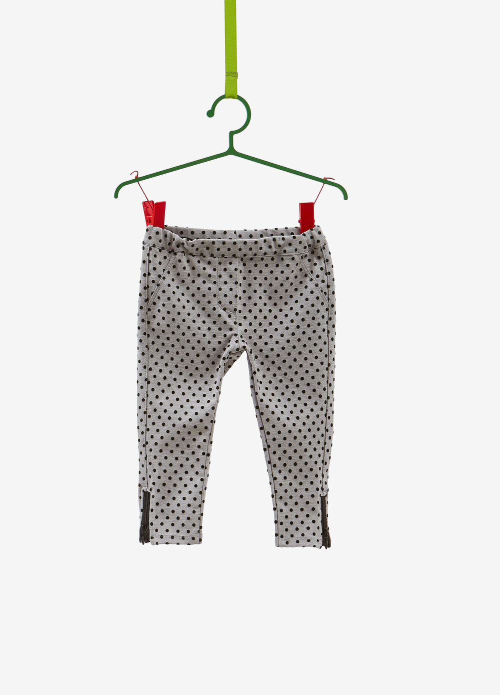 Stretch trousers with polka dot pattern