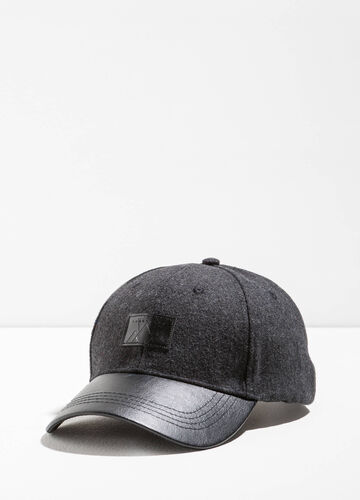 Baseball cap with textured visor