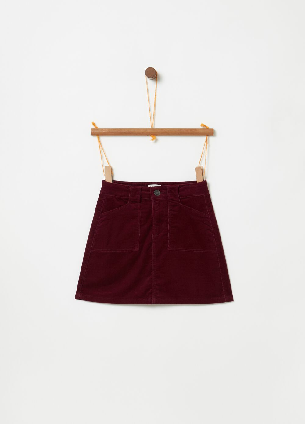 Short stretch velvet skirt with pockets