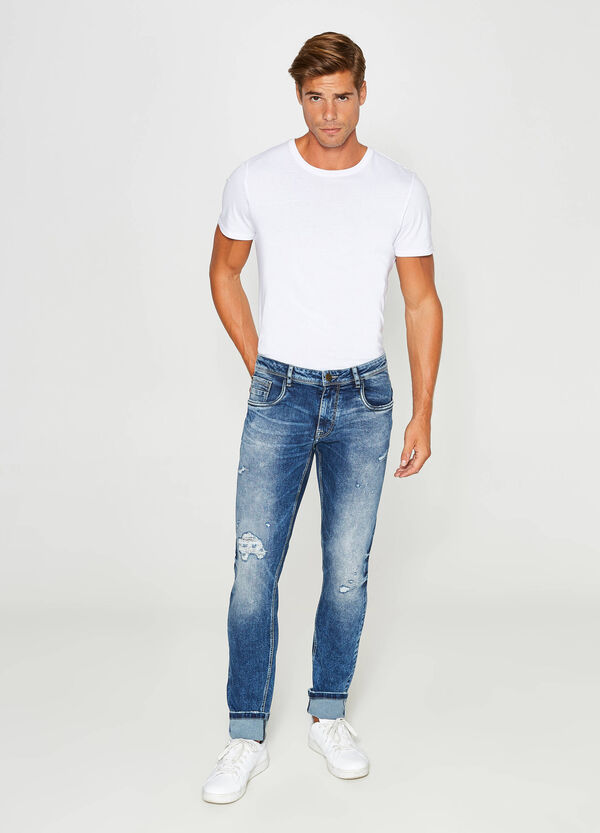 Jeans slim fit stretch used con strappi