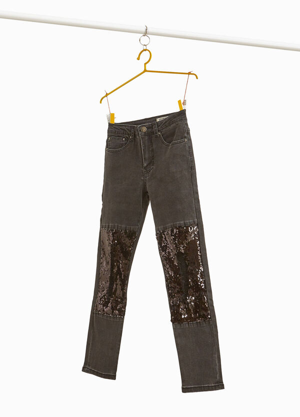 Stretch jeans with sequins and abrasions