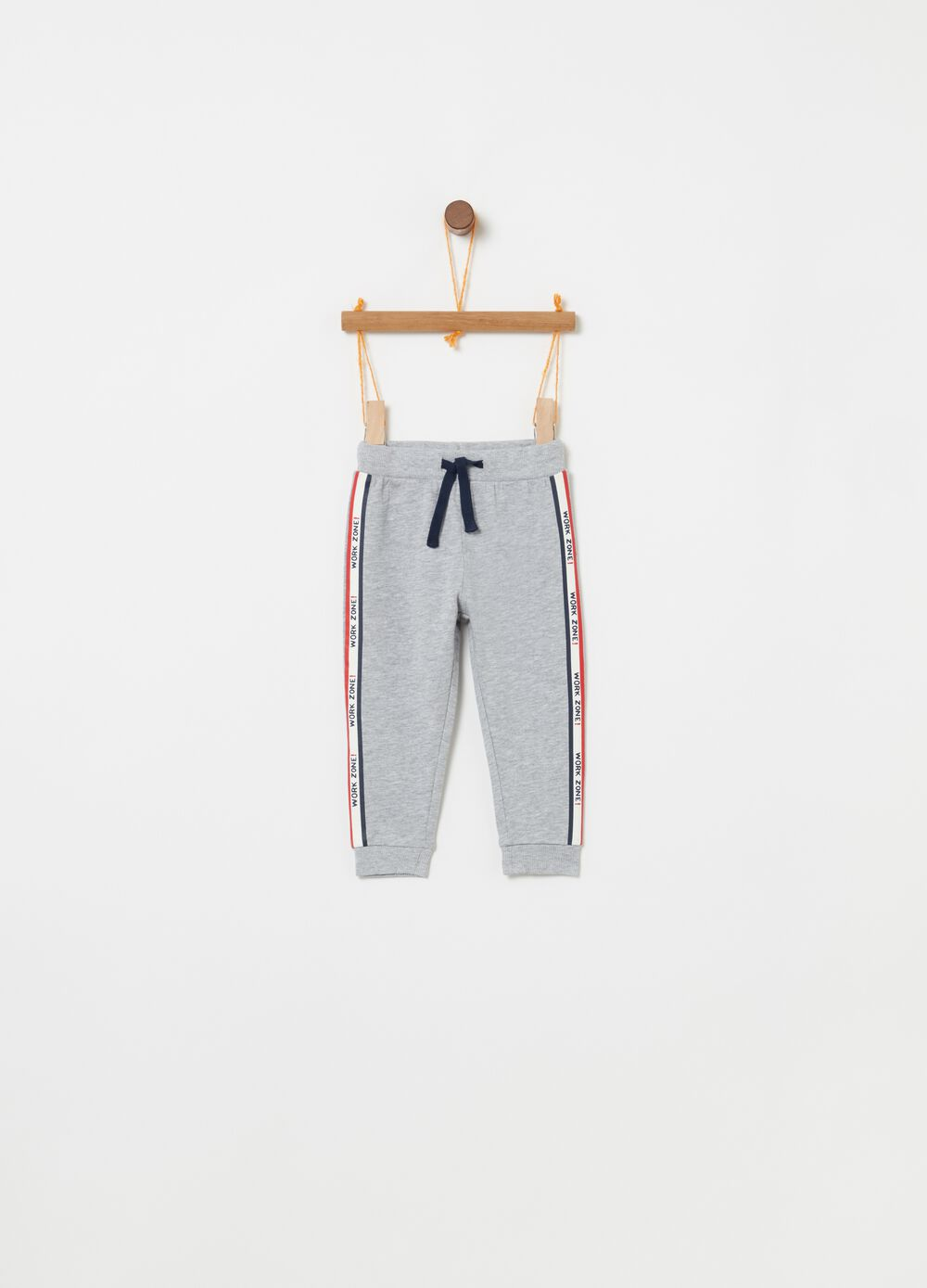Trousers with side bands and lettering print