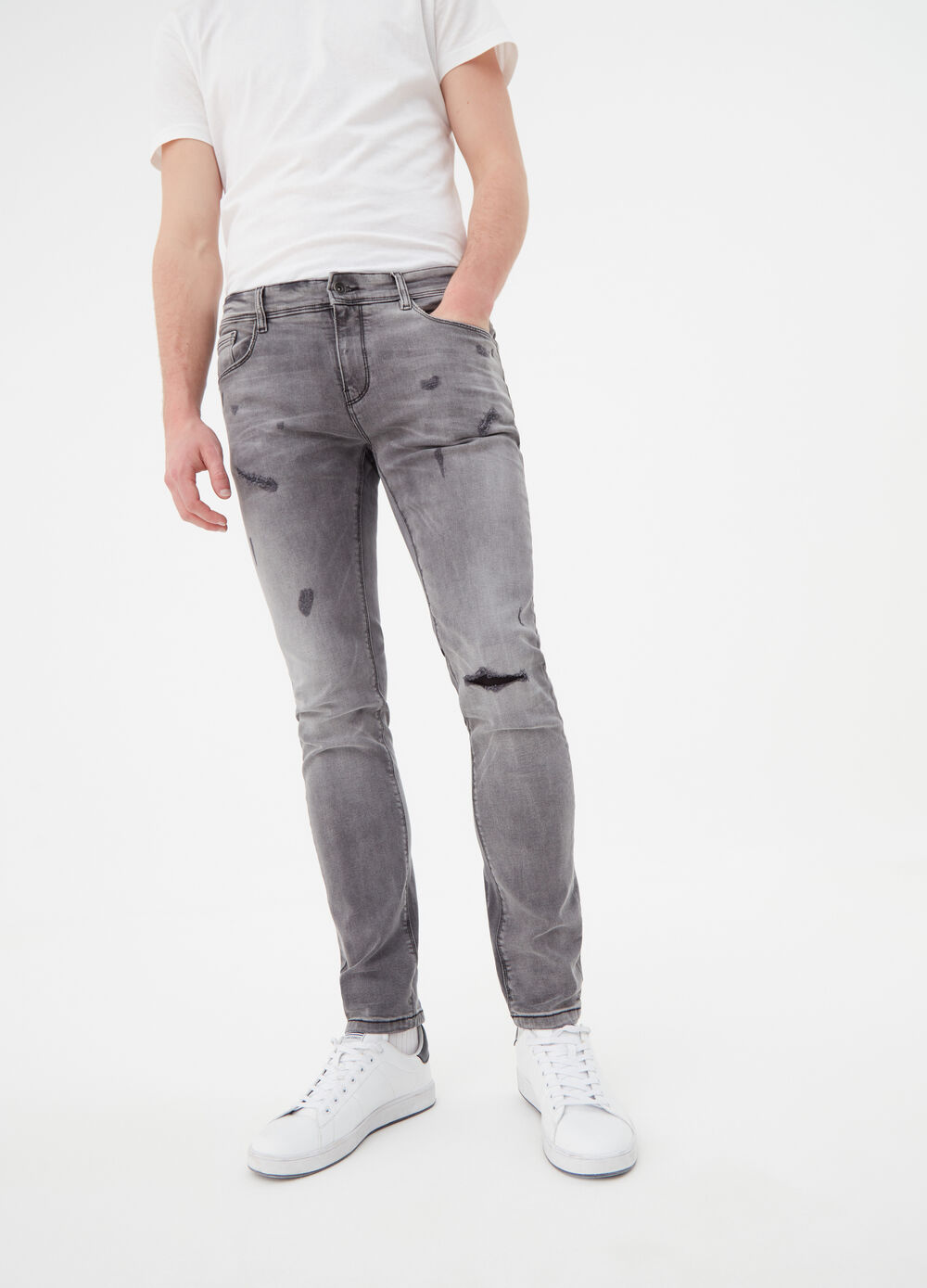 Washed-effect stretch jeans with rips