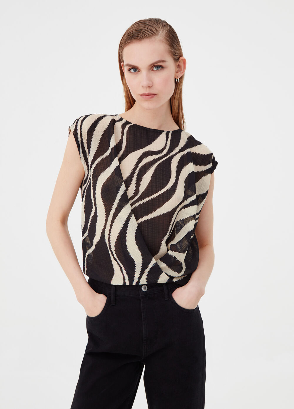 Blusa con incrocio fantasia animalier