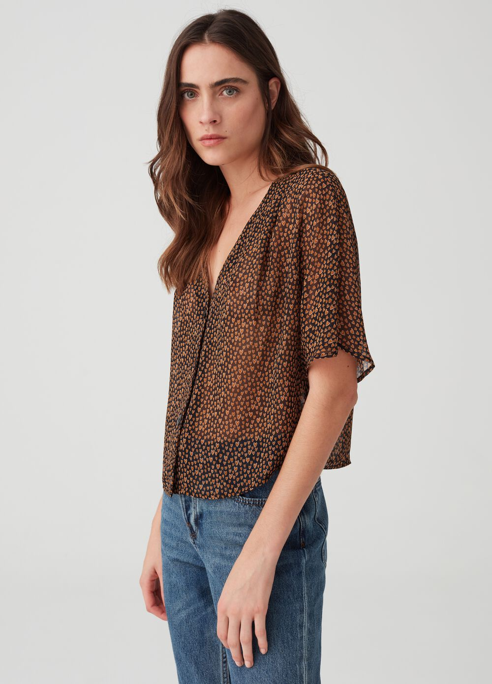 V-neck blouse with hearts print