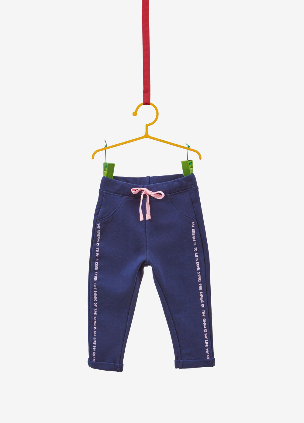 Stretch trousers with glitter lettering