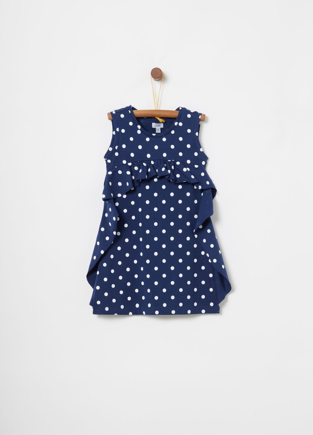 Sleeveless dress with polka dot frills