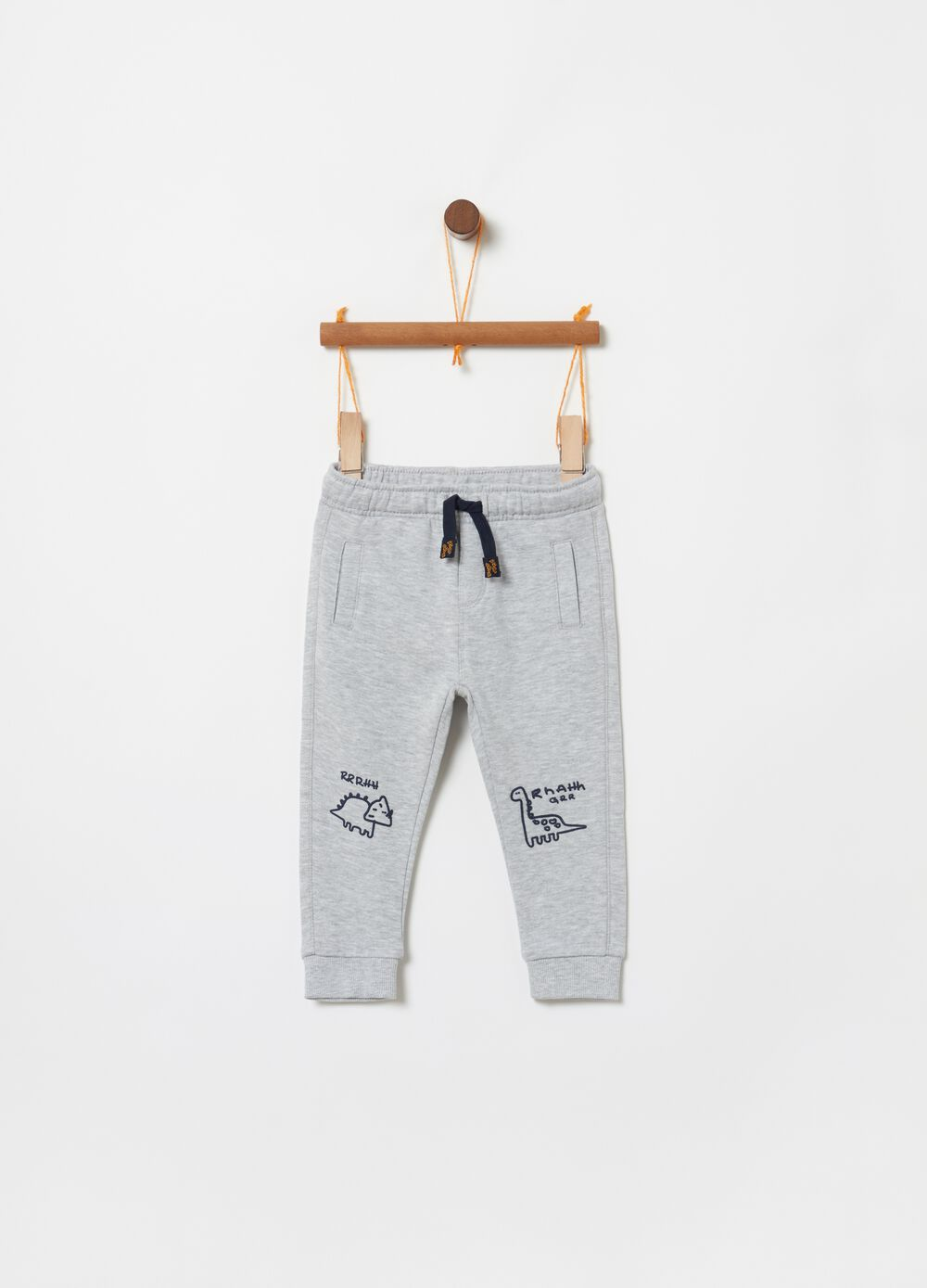 Fleece trousers with dinosaur print