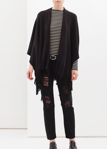 Knitted poncho with fringe