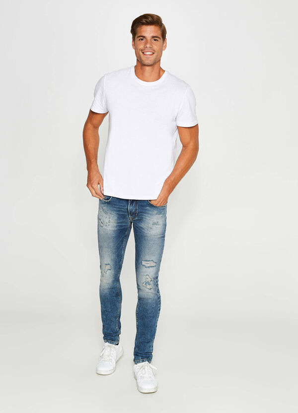 Ripped, skinny-fit misdyed stretch jeans | OVS