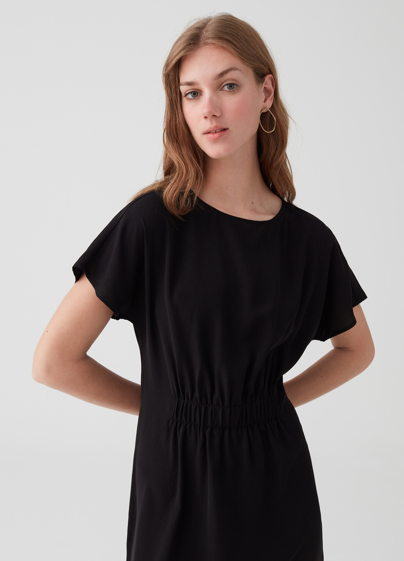 Short dress with smocking and short sleeves. image number null