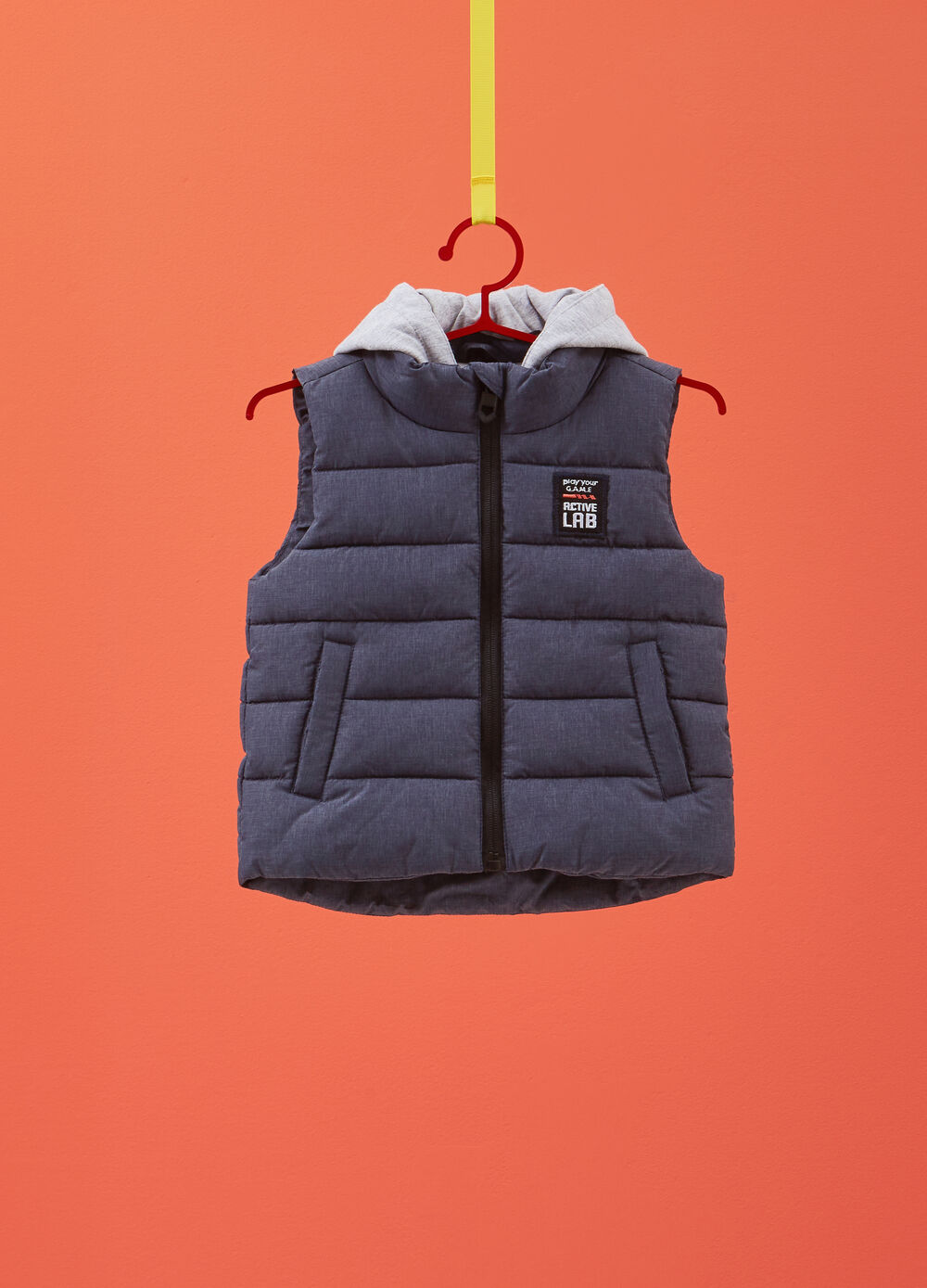 Padded and quilted gilet with patches