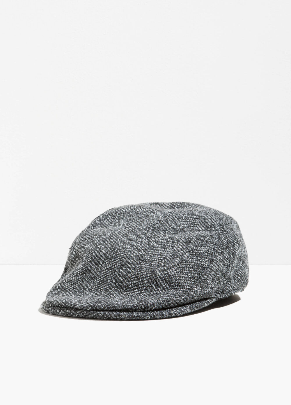 Flat cap with geometric weave