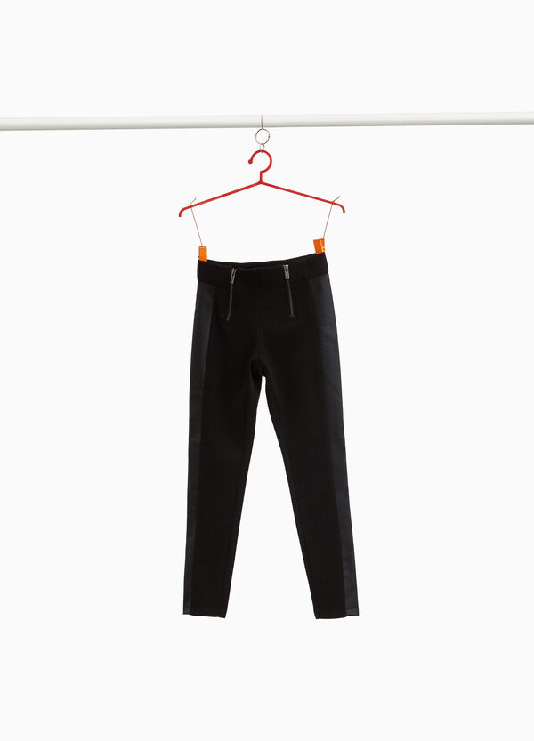 Trousers with shiny bands and double zip