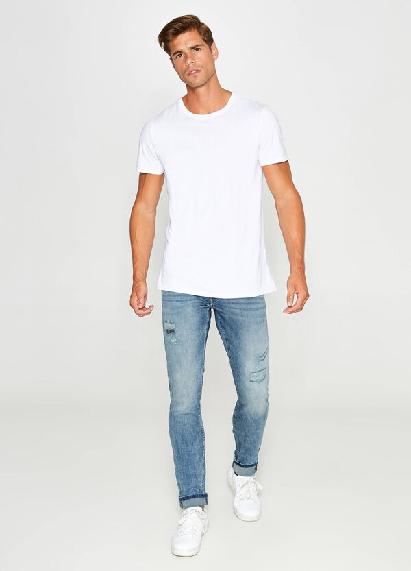 Worn-effect slim-fit stretch jeans with rips | OVS