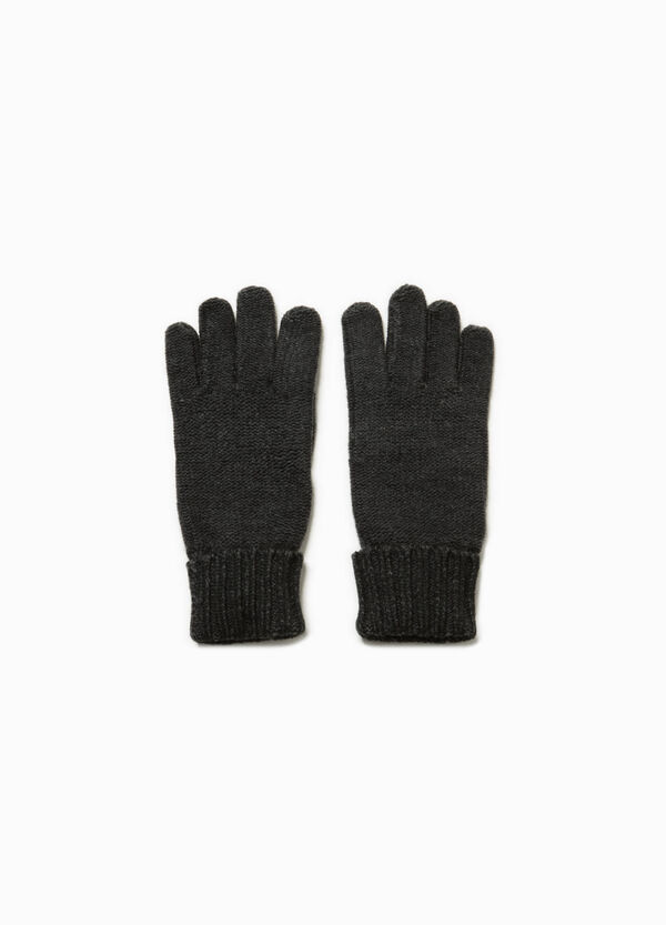 Knitted gloves with folded cuffs