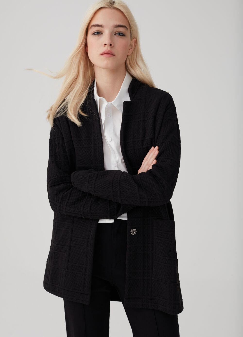 Long, check weave blazer with pockets.