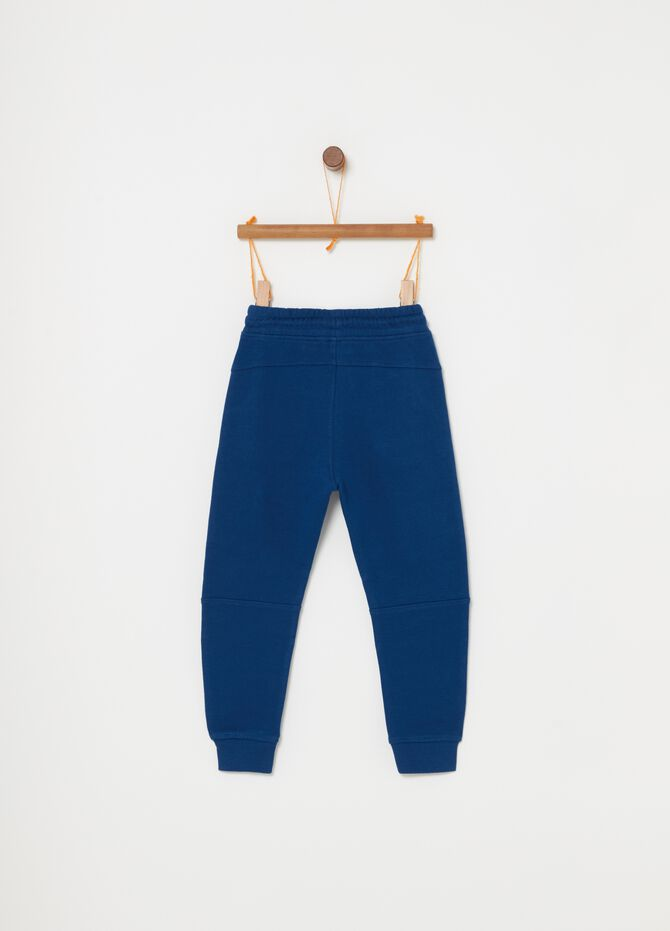 Terry towelling cotton trousers with drawstring.