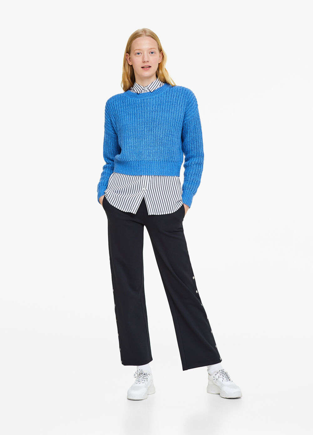Trousers with press-studs on sides