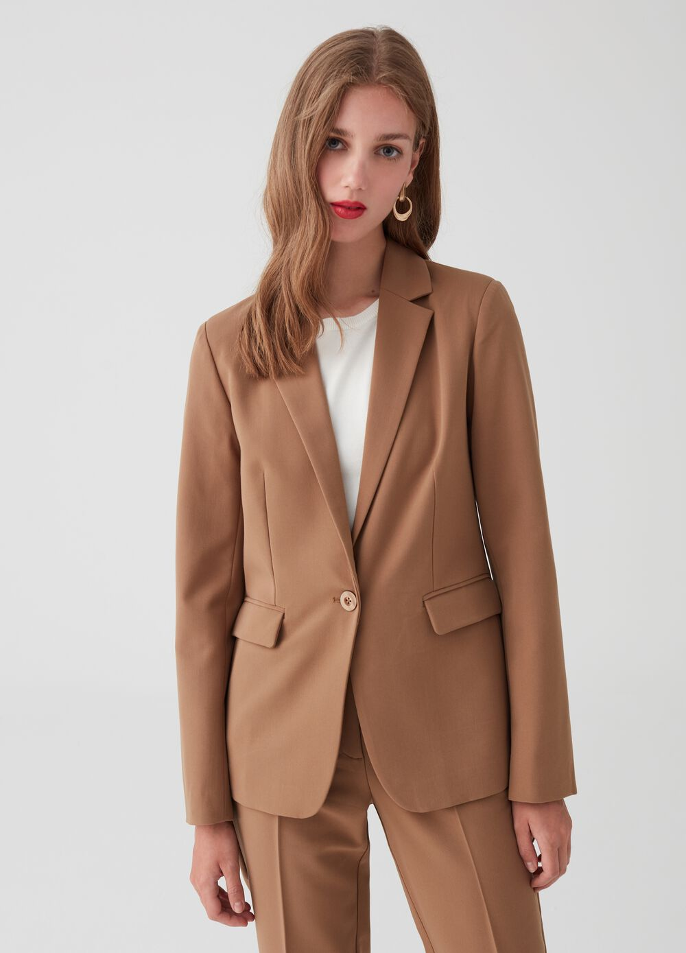 Solid colour blazer with lapels and pockets