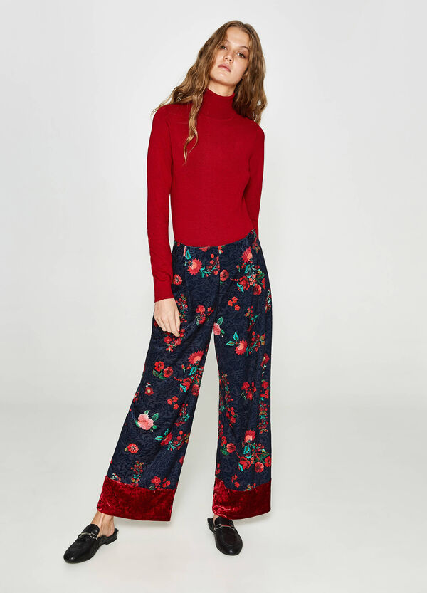 Stretch trousers with all-over floral print