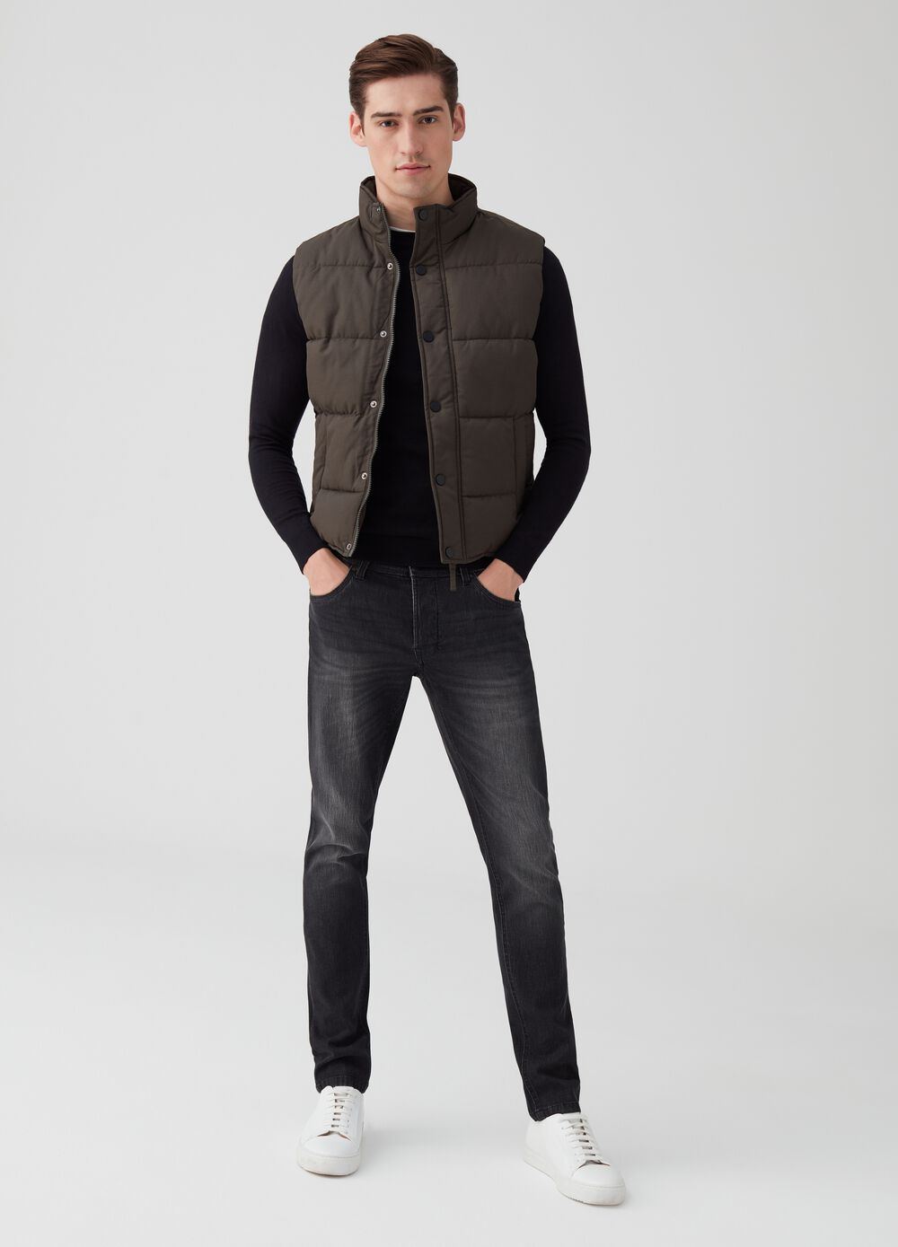 Solid colour padded gilet with high collar and pockets