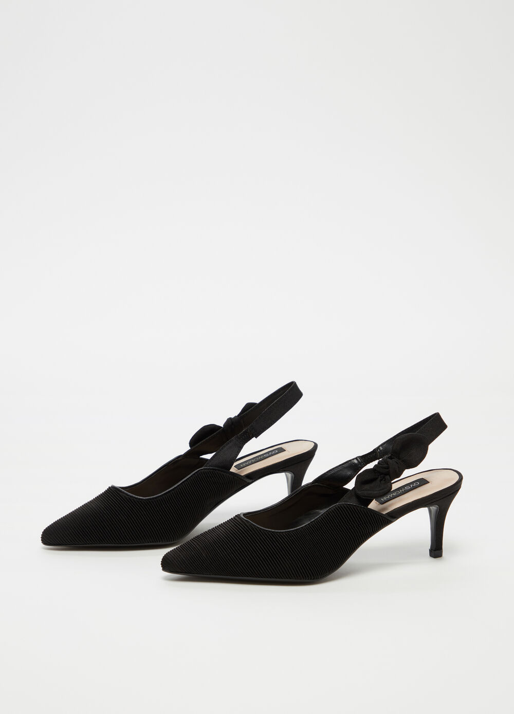 Fabric slingback with strap and bow on the side and average heel