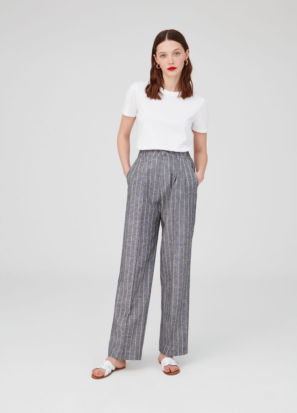 High-waisted trousers in striped cotton and linen