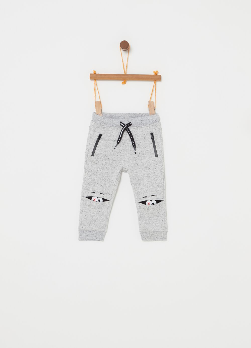 Mélange trousers with pockets, zip and print