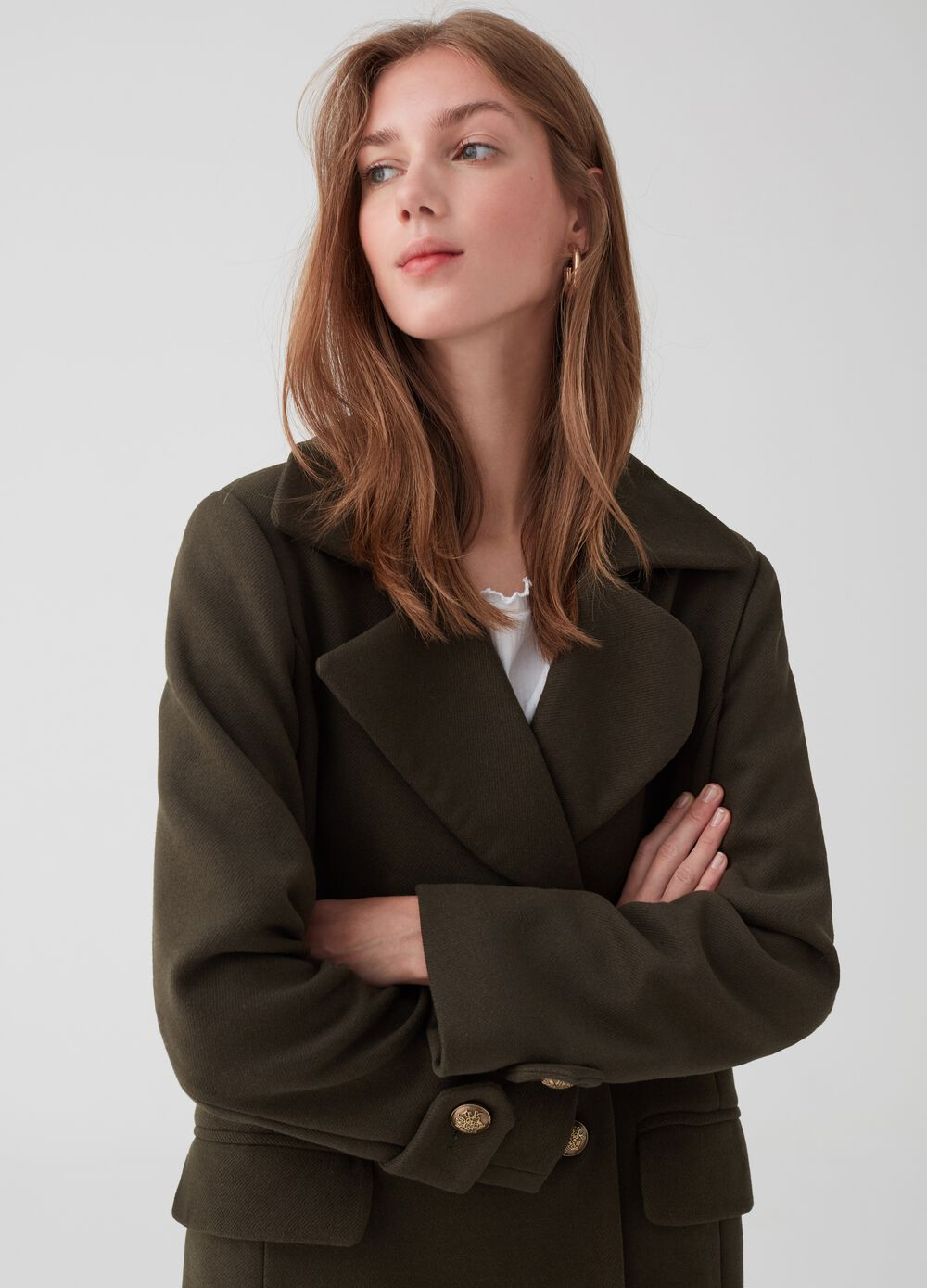 Long coat with lapels, pockets and buttons